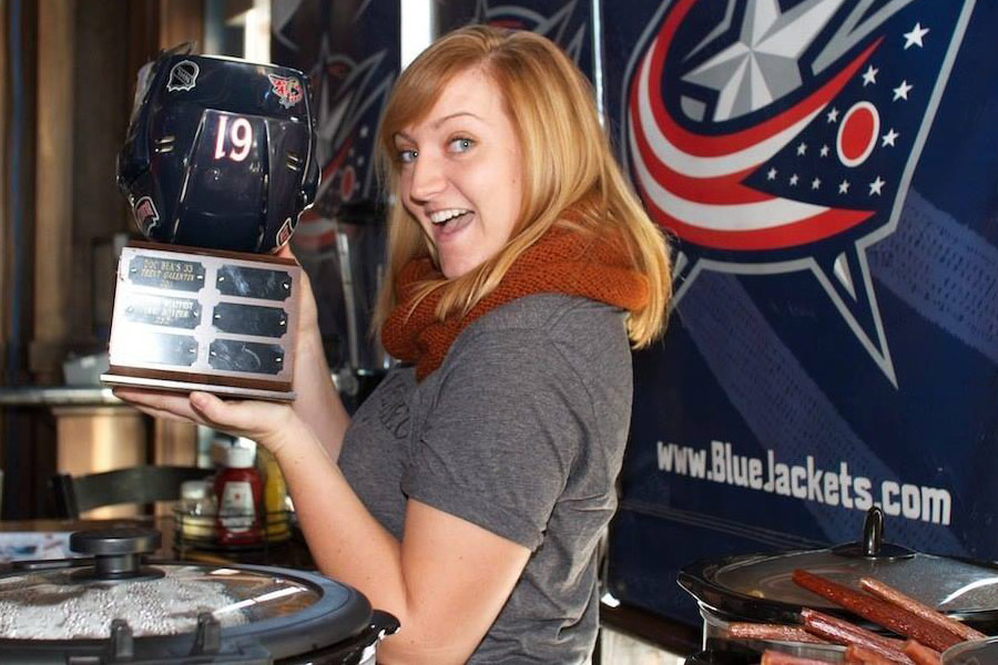 Woman holding Chili Bowl award for best chili recipe